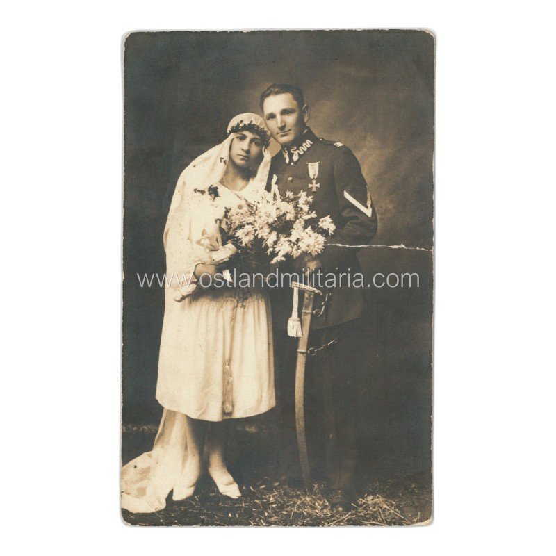 Wedding photo with soldier in Polish uniform. Viln...