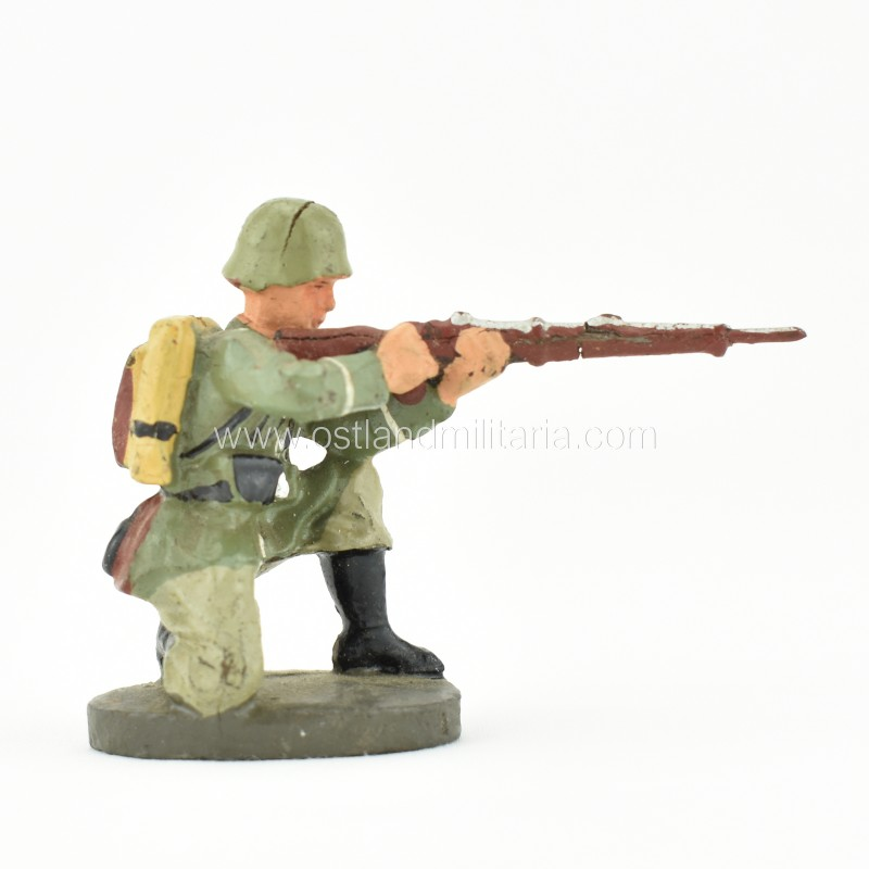 German Elastolin toy soldier with a rifle, kneeling shooting position Germany 1933–1945